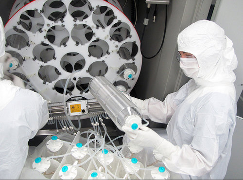 OVMF staff prep the bioreactor to manufacture one of the high-grade, cancer-killing viruses that are produced at the facility for use in clinical trials.